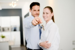 real estate business agent handing out house key of new apartment